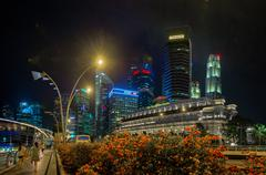 Distinctive Modern Architecture of Singapore's Night Time Skyline Stock Photos