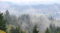 Rolling fog and low clouds over suburb landscape and homes Happy Valley Oregon Stock Footage