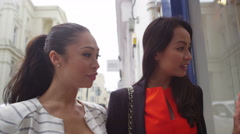 4K Beautiful female friends window shopping in the city. Shot on RED Epic.	 Stock Footage