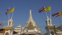 Lak Muang temple and flags in Bangkok, Thailand Stock Footage