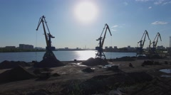 South River Port with several cranes on shore against cityscape Stock Footage