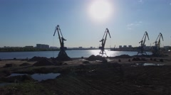 Sun shines above South River Port with several cranes on shore Stock Footage