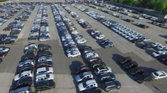 Panorama of parking place with many new cars at sunny day Stock Footage