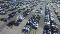 Many new cars on large parking place in city at sunny day. Stock Footage