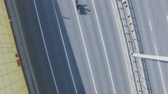 Many bikers drive by road at sunny day. Aerial view Stock Footage