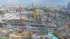 Building site of soccer arena Dynamo near city highway with traffic Stock Footage