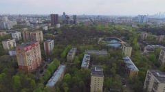 Cityscape with TV tower and residential houses near farm fields Stock Footage