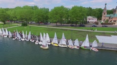 Many boats on moorage and sail by pond near Trinity Church Stock Footage