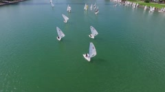 Kids sail on boats during regatta at spring sunny day. Aerial view Stock Footage