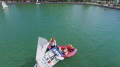 Salvor helps children with their boat during regatta Stock Footage