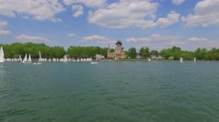Many small yachts sail by pond during regatta near Trinity Church Stock Footage