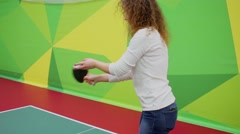 Woman plays table tennis during competition in sport club Stock Footage