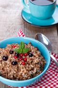 Buckwheat porridge with blueberries Stock Photos
