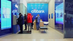 Several people do business in Citibank office Stock Footage