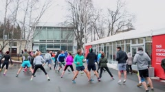 Many people take part in outdoor workout during Reebok event at VDNH Stock Footage