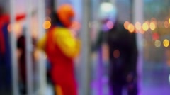 People in sport suits and helmets walk in air tube, unfocused Stock Footage