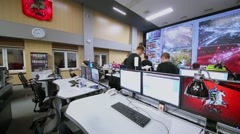 People work in operations room with many displays in data center Stock Footage