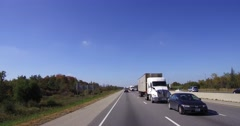 4K Reverse angle POV trucks and cars driving on highway Stock Footage