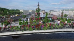 People walk on Tretyakov bridge among flowers and plants in form of heart Stock Footage