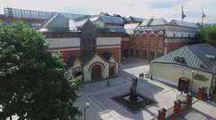 People walk by square near State Tretyakov Gallery at summer Stock Footage