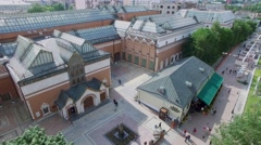 Tourists walk by square with monument near State Tretyakov Gallery Stock Footage