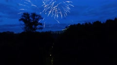 Fireworks in cloudy sky above megalopolis at summer evening Stock Footage