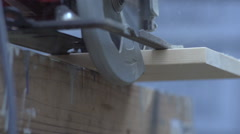 Slow Motion Circular saw cuts through board Stock Footage