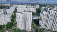 Urban area with residential houses and skyscrapers on horizon Stock Footage