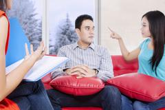 Young couple arguing on the couch Stock Photos