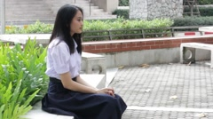 Thai high school student uniform teen beautiful girl happy and relax Stock Footage
