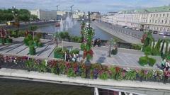 Flowers on fence of Tretyakov bridge with many tourists Stock Footage