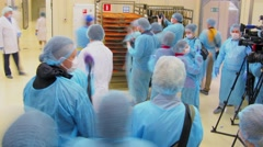 Group of journalists shoot workshop during fish factory tour Stock Footage