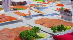 People take red fish appetizers from dinner table. Timelapse Stock Footage