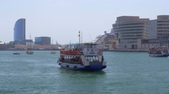 Tourist boat approaching harbour in Barcelona Stock Footage