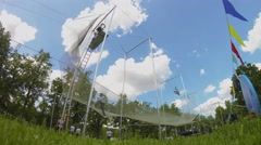 Group of people do exercises on trapeze during YOTA company event Stock Footage