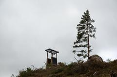 Hunting tower by a single pine tree Stock Photos