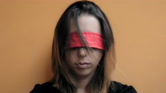 Woman hostage blindfolded lying against the wall Stock Footage