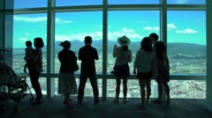 4K Tourists taking photograph with camera phone of above views Taipei city -Dan Stock Footage