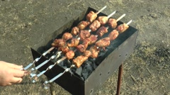 Brazier with a shish kebab, skewers male hand turns. Stock Footage