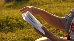 Hands Turning the Page on the Book. the Action in the Mountains. Stock Footage