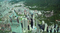 4K Aerial view of Taipei city buildings with Mountain and traffic driving-Dan Stock Footage