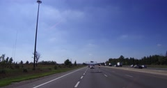 4K POV reverse motion shot of cars trucks driving on the 401 highway in Ontario Stock Footage