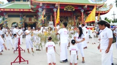 Phuket vegetarian festival people gilding on The ceremony of sacred wood Stock Footage