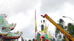 PHUKET, THAILAND October - 1  Cranes lift for  sacred wood poles  symbol  of  Stock Footage