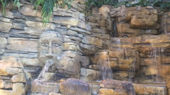 Waterfall flowing over the wall with large stones. Stone face. Stock Footage