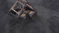 Precipitation of coal from the bucket Stock Footage