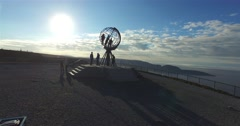 Cinema 4k aerial rising view on the globe monument full of people, at Nordkap Stock Footage