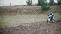 24 september 2016 - Volgsk, Russia, MX moto cross racing - Girl Bike Rider rides Stock Footage