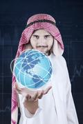 Arabian man holds globe with business network Stock Photos