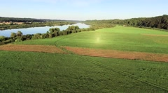 Aerial landcape of river in green meadows Stock Footage